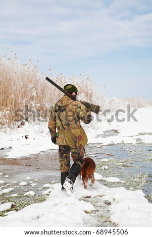 Hunter and his dog waiting for the hunting party to begin. General winter open season photograph