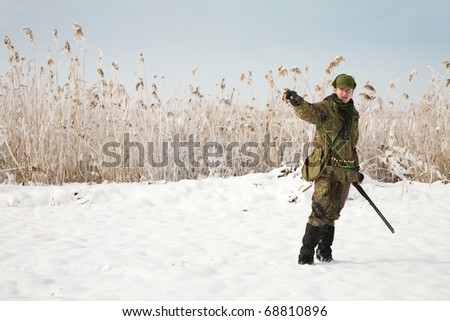 Hunter giving directions to the other hunters. General winter hunting scene during the open season