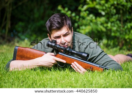 Hunter in the wilderness looking for prey - stock photo