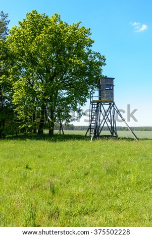 Hunter's raised blind in a summer meadow in Germany. - stock photo