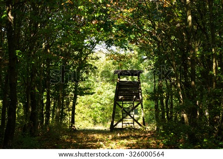Hunter's stand in the forest in autumn time - stock photo