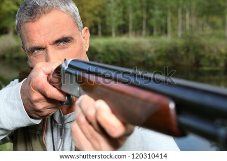 hunter shooting - stock photo