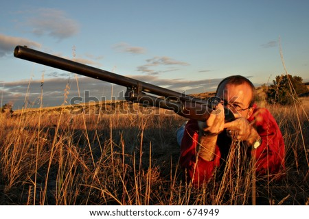 Hunter shooting up - stock photo