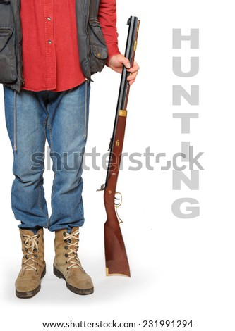 Hunter with rifle and space for your text. - stock photo