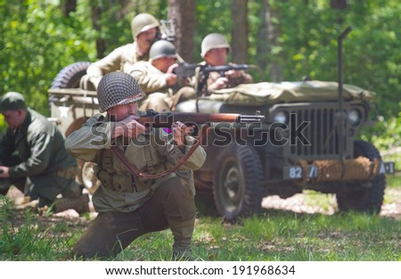 HUNTERSVILLE, NC - MAY 3, 2014:  A military reenactor in an American uniform recreates a World War II battle at Historic Latta Plantation in commemoration of the 70th anniversary of D-Day.