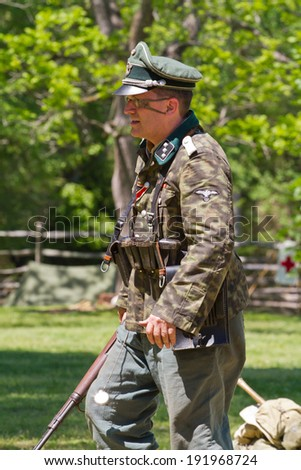 HUNTERSVILLE, NC - MAY 3, 2014:  A reenactor in a German officer's uniform participates in a World War II battle recreation at Historic Latta Plantation in honor of the 70th anniversary of D-Day.
