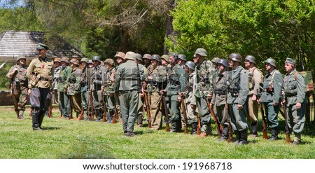 HUNTERSVILLE, NC - MAY 3, 2014:  Military reenactors  in German uniforms recreate a World War II battle at Historic Latta Plantation in commemoration of the 70th anniversary of D-Day.