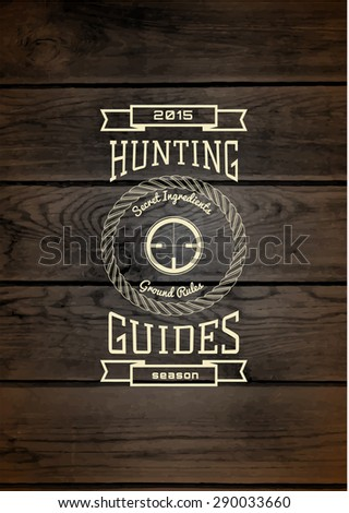 Hunting badges logos and labels for any use, on wooden background texture - stock photo
