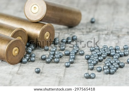 Hunting cartridges and lead shot  on the old wooden boards