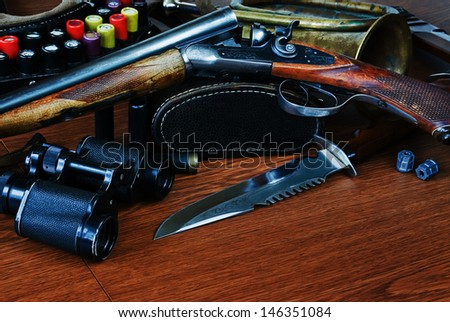 hunting equipment on a wooden board - stock photo