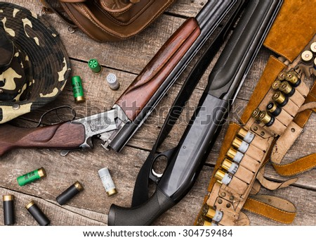 Hunting equipment on old wooden background