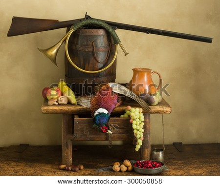 Hunting still life with pheasant, fruit and hare - stock photo