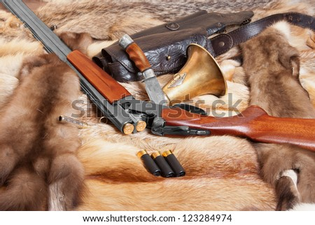 Hunting things on background of the furHunting things on background of the fur - stock photo