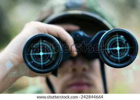 hunting, war, army and people concept - close up of young soldier, ranger or hunter with binocular and virtual projection observing forest - stock photo