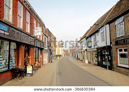 HUNTINGDON, UK - FEBRUARY 27, 2016: Pedestrianised shopping area. Huntingdon is a market town, located in Cambridgeshire and the birthplace of Oliver Cromwell.  - stock photo