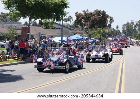 HUNTINGTON BEACH, CA - JULY 4: Shriners riding in classic cars during Huntington Beach July 4th parade. - stock photo