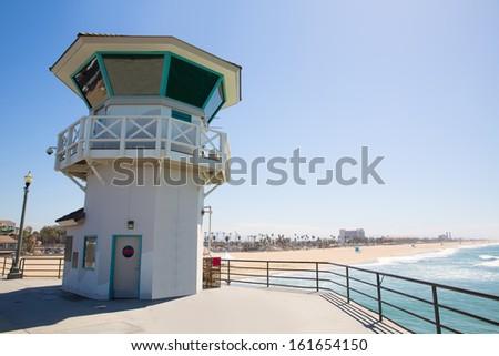 Huntington beach main lifeguard pier tower Surf City California USA - stock photo