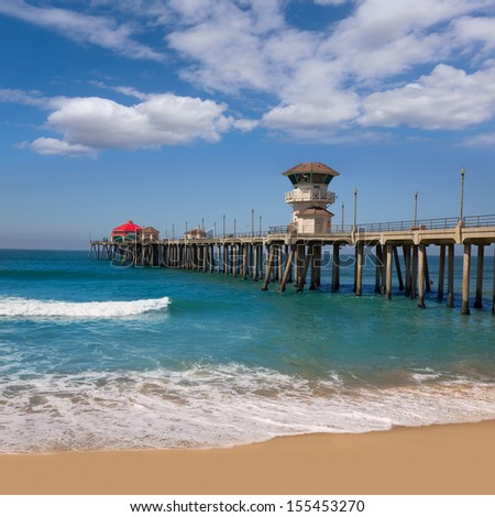 Huntington beach Surf City USA pier view with sand and waves - stock photo