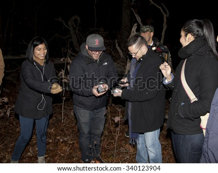 HUNTINGTON, NEW YORK, USA - NOVEMBER 14: Members of the Brooklyn Paranormal Society of NY during their investigation of Mount Misery Road in Long Island.  Taken  November 14, 2015 in NY. - stock photo