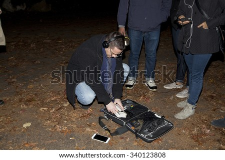 HUNTINGTON, NEW YORK, USA - NOVEMBER 14: Ron Yacovetti checks recording device during Brooklyn Paranormal Society's investigation of Mount Misery Road in Long Island.  Taken November 14, 2015 in NY.