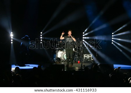 HUNTINGTON, NY-DEC 11: Country music artist Chris Lane performs onstage at the Paramount on December 11, 2015 in Huntington, New York.