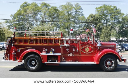 HUNTINGTON, NY - SEPTEMBER 7: 1950 Mack fire truck from Huntington Manor Fire Department at parade in Huntington on September 7, 2013. Huntington Manor Fire Department organized in 1903 - stock photo