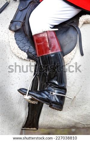Huntsman's boot in stirrup - stock photo