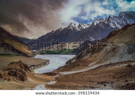 Hunza river flowing through the beautiful mountain valley near Passu in the northern part of the Karakorum mountains in Pakistan - stock photo