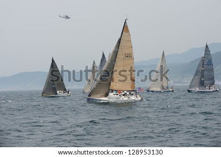 HUPO, SOUTH KOREA - MAY19: Korea Cup International Yacht Race. Yachts are struggling for first place on 19 May 2012 in Hupo, South Korea - stock photo