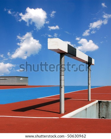 Hurdle on an athletic track with blue sky