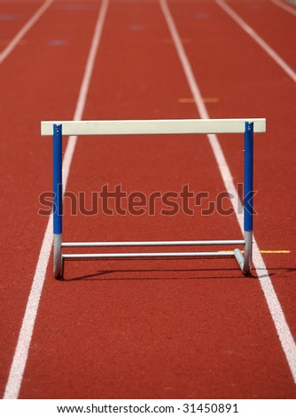 Hurdle on Synthetic Athletic Track - stock photo