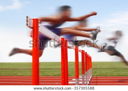 Hurdle race, men jumping over hurdles in a track and field race. Motion blurred image, digitally altered unidentifiable face. - stock photo