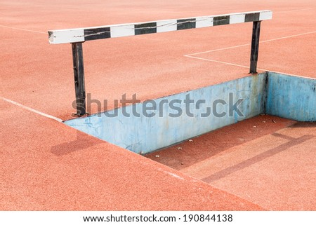 Hurdles on running track, Thailand - stock photo