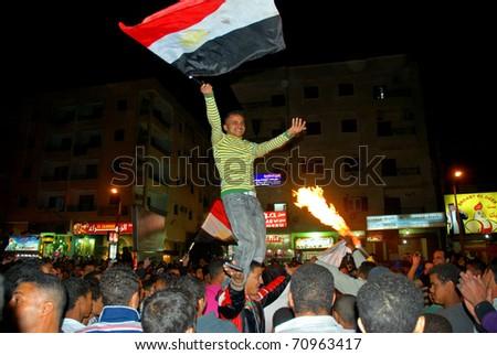 HURGHADA, EGYPT - FEBRUARY 11: People celebrate resignation of Hosni Mubarak from the position of President on February 11, 2011 in Hurghada, Egypt. - stock photo