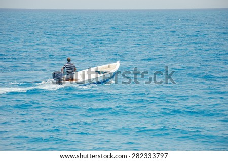 Hurghada, Egypt - July 10, 2014: A man floating in a motorboat