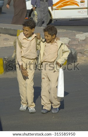 Hurghada, Egypt - November 7. 2006: Pupils come back home from school - stock photo