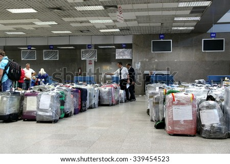 Hurghada, Egypt, November 2015: tourists evacuated from egypt collected and will be send to theirs countries by separate plane, airport workers checking the tags - evacuation of tourists from egypt