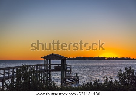 Hurricane Hermine damage to a pier in Cedar key, Florida at sunset