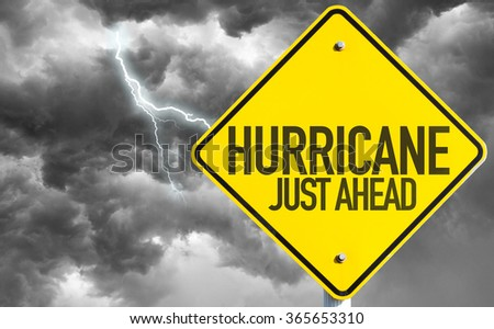 Hurricane Just Ahead sign with a bad day - stock photo
