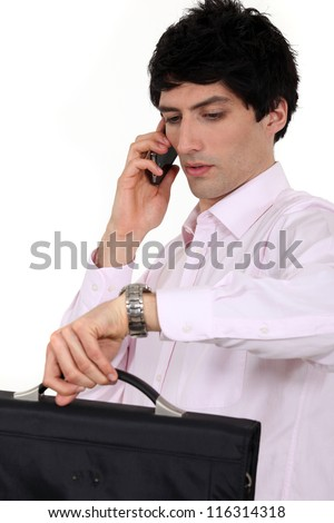 Hurried businessman looking at the time