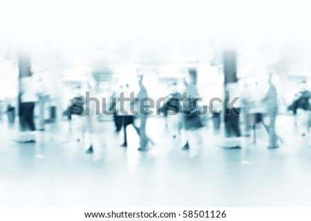 Hurrying crowd of people in the subway corridor. Abstract picture. - stock photo