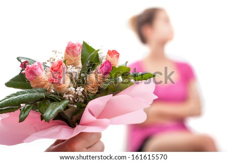 Hurt woman and bouquet of flowers from her husband - stock photo