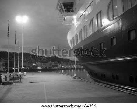 Hurtigruta cruise ship docked in black and white. - stock photo