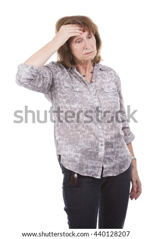 hurting older caucasian woman wearing casual outfit on white isolated background