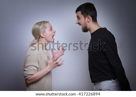 Husband and wife arguing, man and woman screaming. Family quarrel.   - stock photo