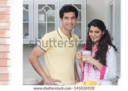husband and wife in the kitchen, Indian couple in the kitchen - stock photo