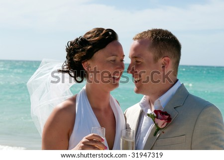 Husband and wife portrait with ocean landscape