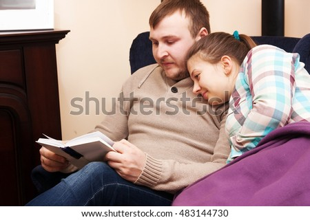 husband and wife reading book  at home together