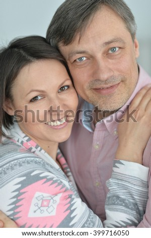 husband and wife spend time together on a gray background - stock photo
