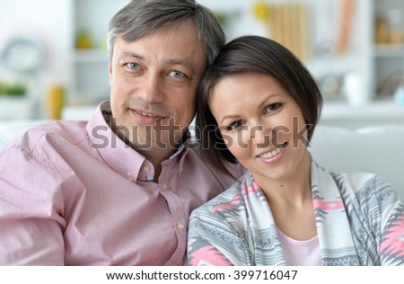husband and wife spend time together on the couch